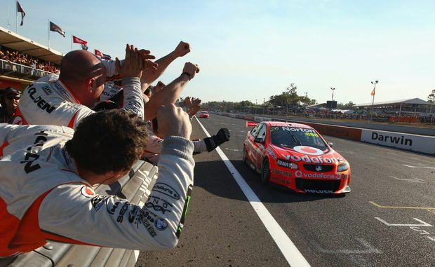Craig Lowndes driver of the #888 Team Vodafone Holden crosses the line to win race 13 of the V8 Supercars Championship Series at Hidden Valley Raceway on June 17, 2012 in Darwin, Australia.