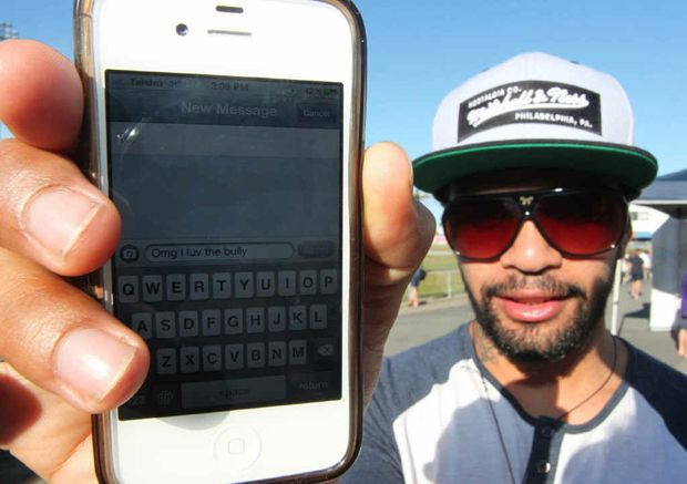 Kayan Davis doesn't worry about spelling when he is texting on his iPhone.