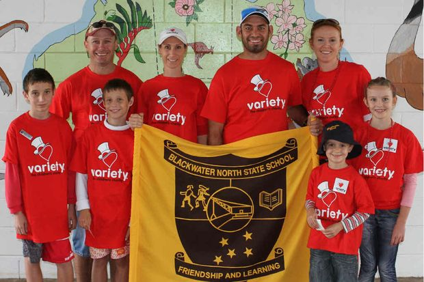 Lara Conaghan and Aaron Broderick (middle) and their families held a fundraiser Blackwater North State School.