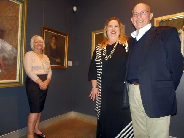Lyn Stewart, Susi Muddiman and Bob Gibson pictured with a portrait of late artist Bessie Gibson's mother: Mrs Walter Lockhart Gibson.