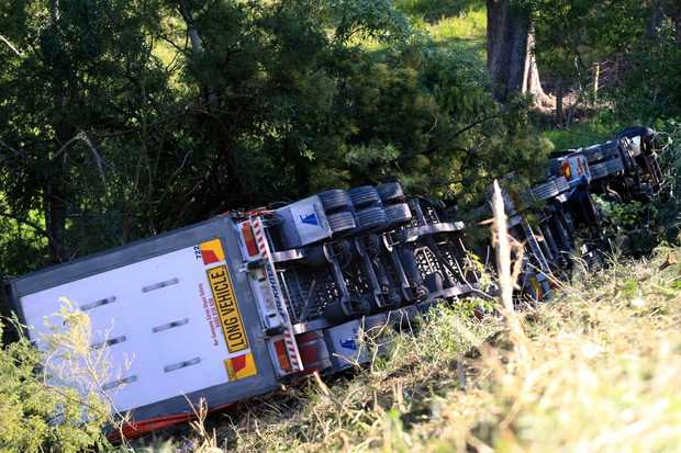 The truck carrying fruit and vegetables rolled off the Pacific Hwy near Pottsville.