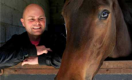 Local trainer Matthew Dunn with Our Triple Treat, one of the big hopes in tomorrow's Murwillumbah Cup, which has attracted a handy field of middle-distance gallopers.