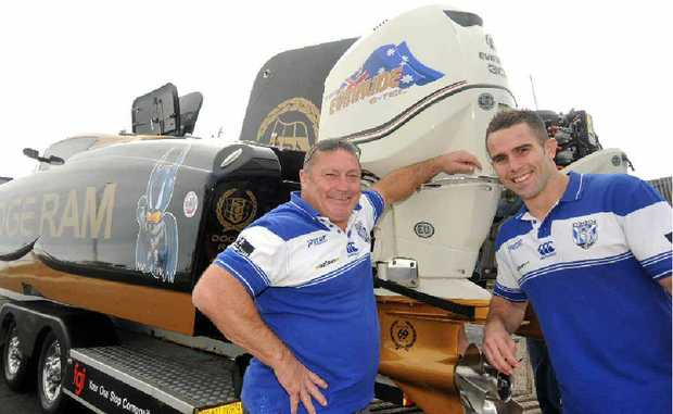 Former Bulldogs player Terry Lamb and current player Steve Turner get a taste of the offshore racing boats that will race around Mackay Harbour.