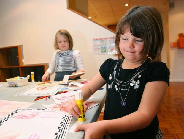 Hayley Kluver, 5 (foreground) with Lauren Kluver, 7, get creative during school holiday activities at the Rockhampton Art Gallery.