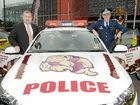 Queensland Police Minister Jack Dempsey and Police Commissioner Bob Atkinson with a special State of Origin design police car that will escort the Queensland team on the night of the Origin decider.