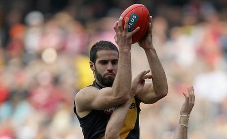 Bachar Houli of the Tigers marks ove Ben McGlynn of the Swans during the round 21 AFL match between the Richmond Tigers and the Sydney Swans at Melbourne Cricket Ground on August 14, 2011 in Melbourne, Australia.