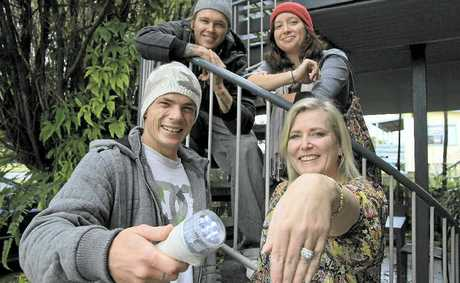 RESCUE team Kendall Pryor and Michael and Danielle Dean, with Yamba's Lisa Westerman with her precious ring.