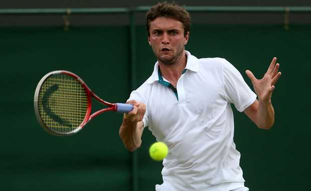 Gilles Simon of France hits a forehand return during his Gentlemen's Singles second round match against Xavier Malisse of Belgium on day four of the Wimbledon Lawn Tennis Championships at the All England Lawn Tennis and Croquet Club