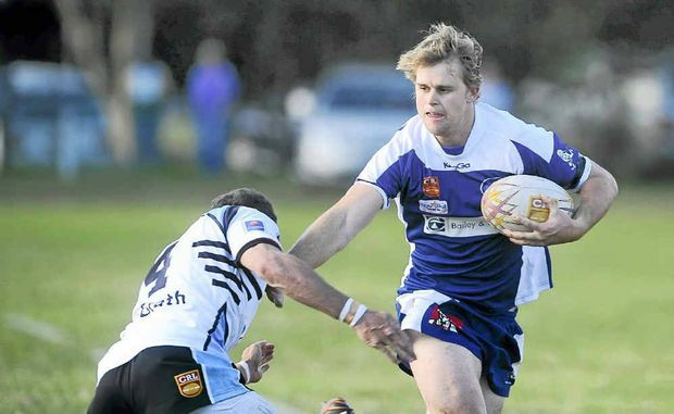 Ghosts centre Aaron Hartmann palms off his Ballina rival during the NRRRL match at Frank McGuren Park yesterday.