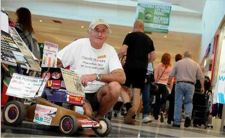 Claude Harvey is pushing his lawnmower from the Gold Coast to Mt Isa to raise money for Bravehearts a
