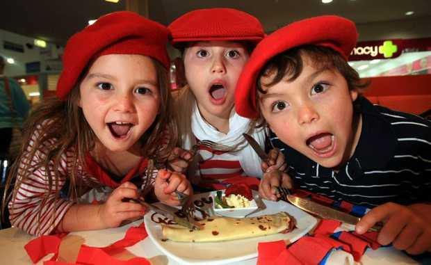 Domino Holland, Zoe Hanna and Charlie Holland enjoying a delicious French crepe at the Red Monkey Cafe in Kingscliff.