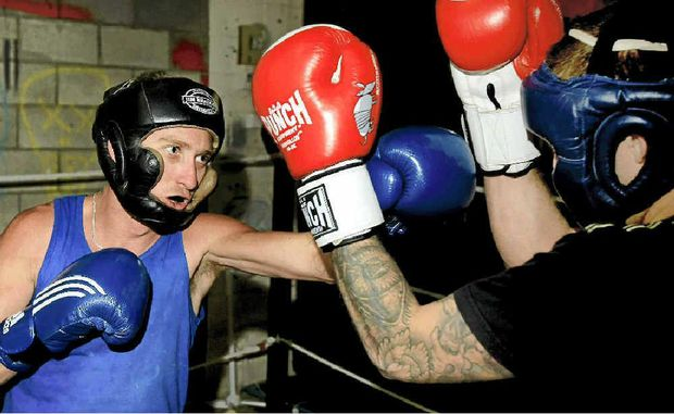 Mick McAndrew strives to place a straight left between Elliott Balk's gloves during a spar at Balk's South Tweed Heads gym on Wednesday. McAndrew headlines Stuart Stone's fight card at Condong tonight. Photo: John Gass TWE030712boxing1