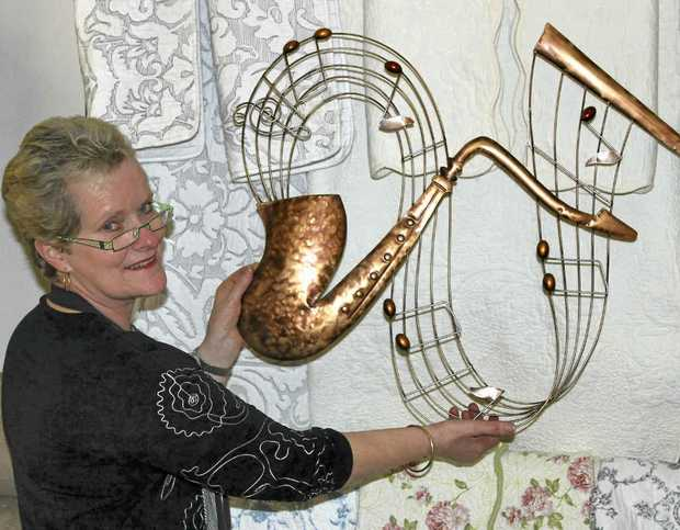 Lynn Bryson is decorating her shop in preparation for Jumpers and Jazz.