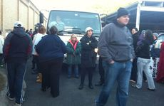 People block the path of a Corrective Services van at the Hoof Street entrance to the Grafton Jail