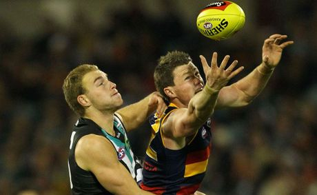 Patrick Dangerfield of the Crows marks over Andrew Moore of the Power during the round 15 AFL match between the Port Adelaide Power and the Adelaide Crows at AAMI Stadium
