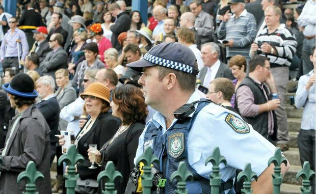 Constable David Ford takes a look over the large crowd on Grafton Cup day.