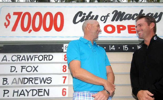 Professionals Adam Crawford, left, and Daniel Fox celebrate after they were named joint winners of the Mackay Open golf championship.