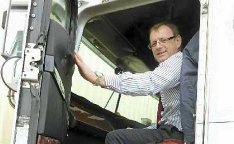 FIGHT FATIGUE: NHVR project director Richard Hancock gets a taste of trucking life in Rod Hannifey's Truckright truck.