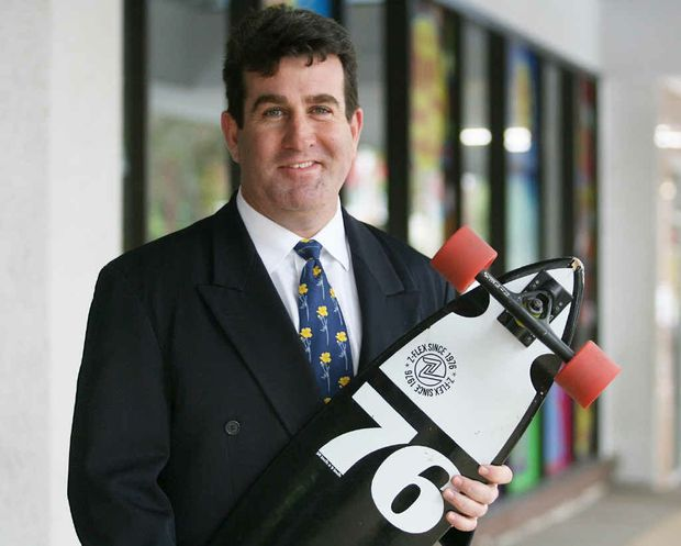 Rockhampton solicitor Brian McGowran rides a skateboard from his home in Wandal to his East St office almost everyday.