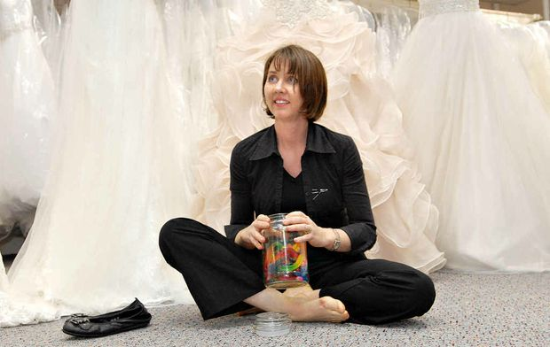 Tania Sandford de-stresses with the lolly jar at Jill Burston for Brides. A small break and a little bit of sugar is one of the ways staff relax at the city bridal and formal dress shop.
