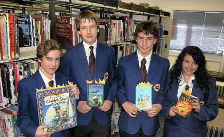 The students behind the Warwick State High School Readers Challenge with the books read by the primary school students (from let) Joe Greenaway, Brendan Austin, Jaron Clark and Aisling Pryor.
