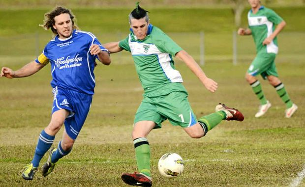 Maclean Bobcats player Jarred Doyle tries to get a shot off under pressure from a Woolgoolga player in a match earlier this month. The Bobcats will travel away to take on the Boambee Bombers.
