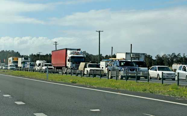 Road death toll down but traffic still queues up on Pacific Hwy.