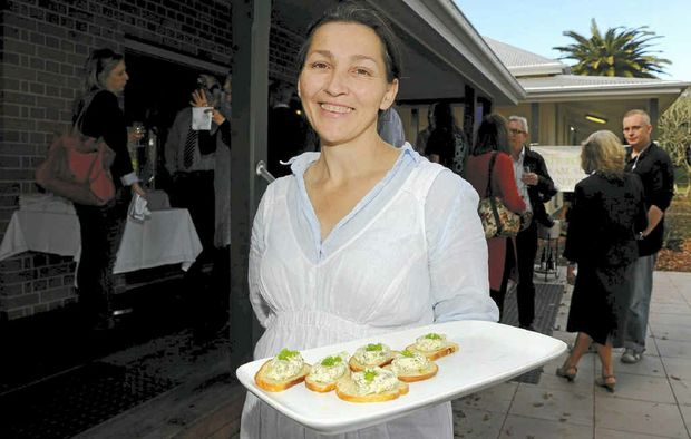 Grafton Art Gallery cafe proprietor Liza Bloomer has a task on her hands to decide a name for her cafe from more than 100 entries that have flooded in through the Examiner's website.