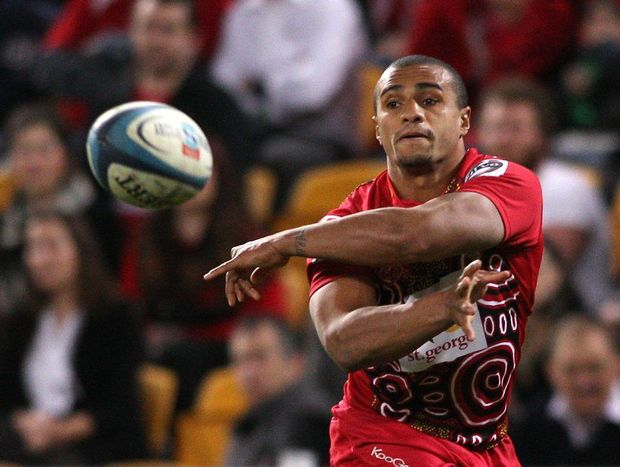 Will Genia of the Reds passes the ball during the round 17 Super Rugby match between the Reds and the Highlanders at Suncorp Stadium on July 6, 2012 in Brisbane, Australia.