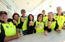 Port of Mackay Rotary Club volunteers (from left) Paul Eyles, Di Hatfield, Peter Grant, Hermina Vickers, Maryanne Edwards, Greg McNeill, Pamela Bazin and Geoff Catto raise a toast to QME.