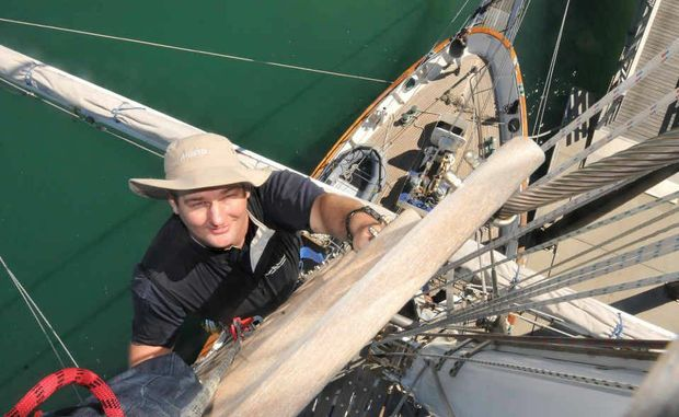Young Endeavour watch leader Josh Bignell has a unique view of Mackay Marina as he climbs the tall ship's 35-metre (105ft) mainmast.