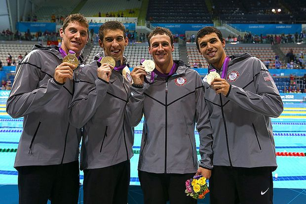 (L-R) Gold Medallists , Conor Dwyer, Michael Phelps, Ryan Lochte and Ricky Berens of the United States pose with the medals won the Men's 4 x 200m Freestyle Relay final on Day 4 of the London 2012 Olympic Games at the Aquatics Centre on July 31, 2012 in London, England.