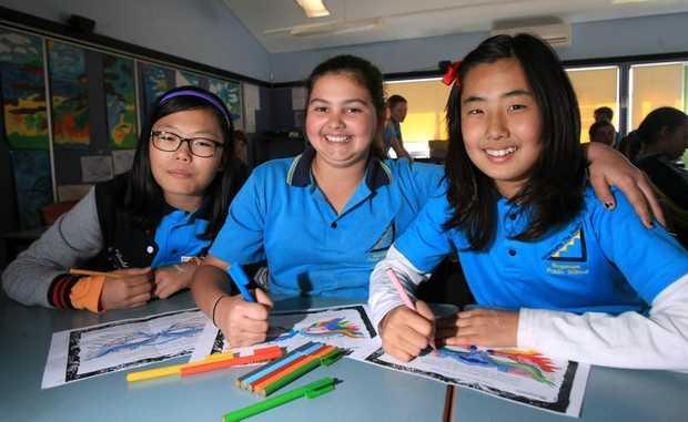 Luchia Chio, Zoe Smith and Sarah Kim, of South Korea, are visiting Bogangar Public School.