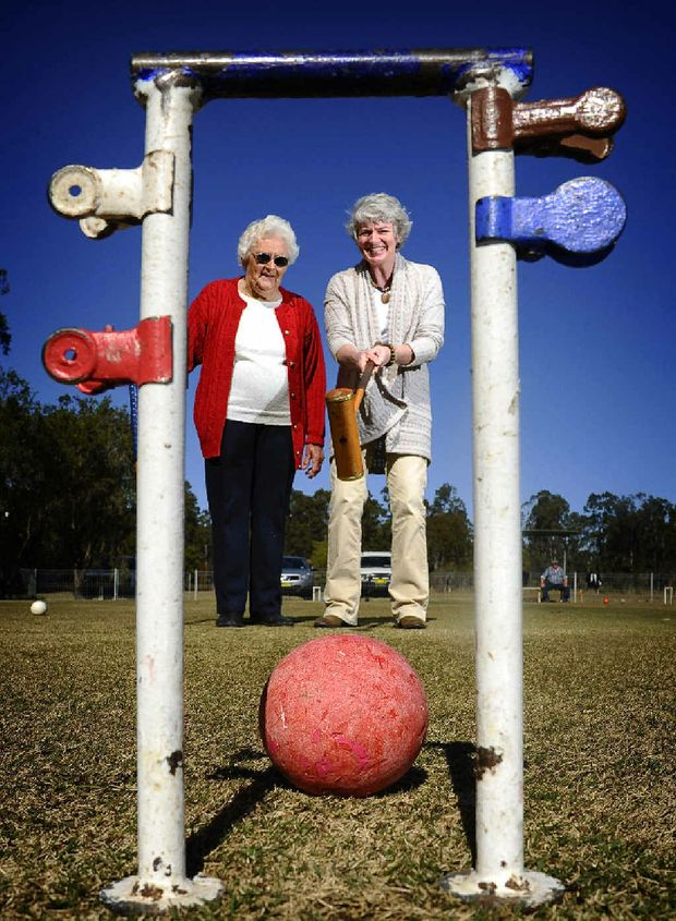 President of the Coutts Crossing Croquet Club Pat Fletcher shows community relations officer with Westpac Rescue Helicopter Rebekah Goodwin the finer points of the game.