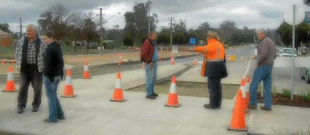 PROGRESS: Bunny Brown (middle) meets with Wagga Councillor Alan Brown in the main street of Tarcutta.