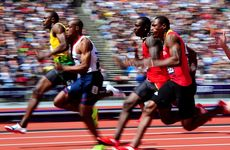 (L-R) Usain Bolt of Jamaica and James Dasaolu of Great Britain compete in the Men's 100m Round 1 Heats on Day 8 of the London 2012 Olympic Games