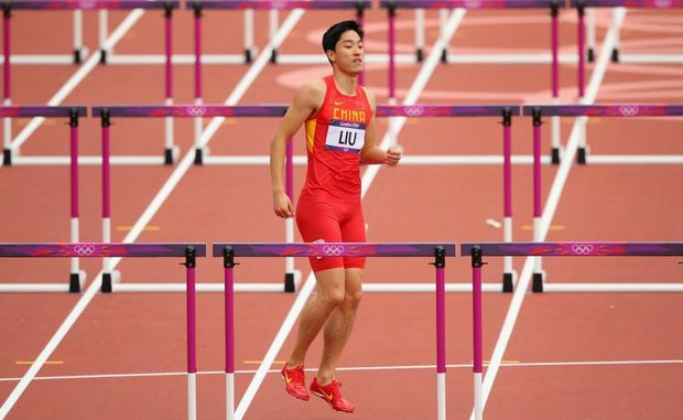 Xiang Liu of China hops on the track after getting injured in the Men's 110m Hurdles Round 1 Heats on Day 11 of the London 2012 Olympic Games at Olympic Stadium on August 7, 2012 in London, England.