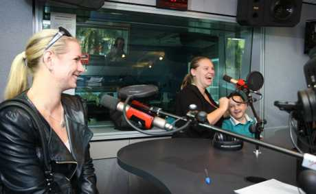 Renee Jenkins and daughter Inez, 7, with Laine Gregory (left), had been raising funds to buy a car – until Ben Carreira of Caloundra City Autos gave them