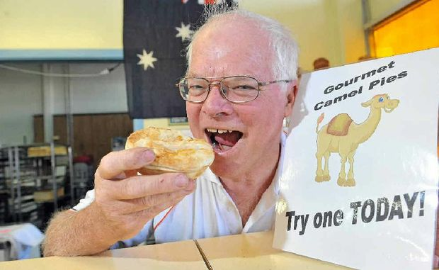 Tradewinds on Woongarra bakery owner Greg Callaghan with one of his tastebud-tingling camel pies.
