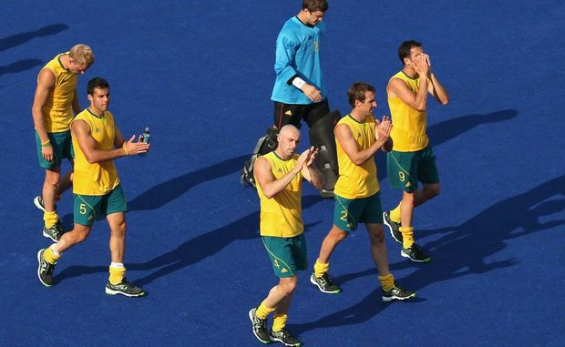 Australian players look dejected at the end of the men's Hockey semi-final match between Australia and Germany on Day 13 of the London 2012 Olympic Games.