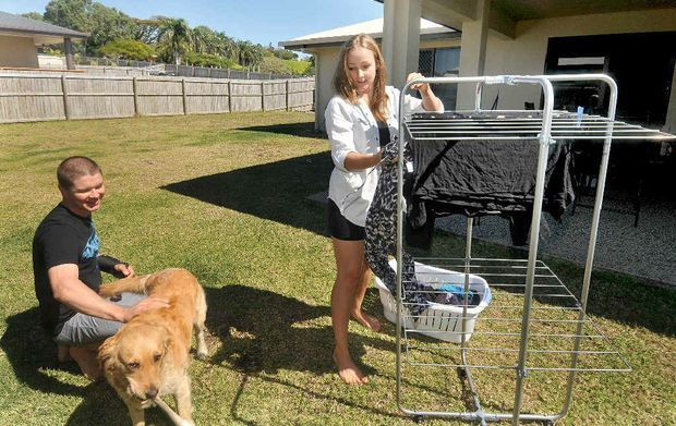 Kraig Thornton and Lacey Bright, with their dog Lily, would like to live alone but are looking for people to share the high cost of renting a house at Rural View.