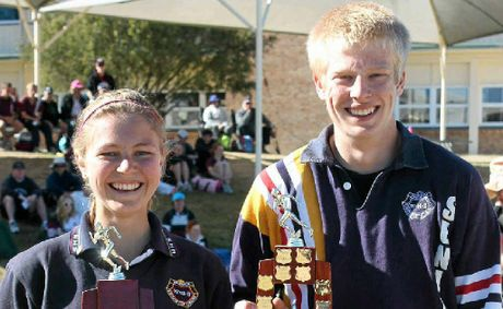 Alison Burrill and Jarrod Walker of Warwick State High School with their trophies.