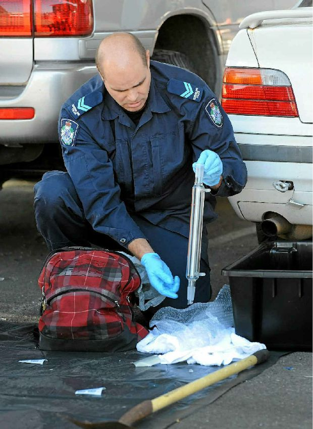 The Illicit Laboratory Investigation Team process a drug lab that was found in the back of a car in Bundaberg on Thursday night.