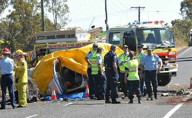Emergency service crews at the scene of the fatality on the Bruce Hwy on Friday.