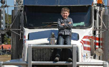 Saxon Fatnowna was riding high on his Pop Ossie Fatnowna's truck after the Konvoy 4 Kids drove into Mackay showgrounds yesterday. The annual event raised about $18,000.