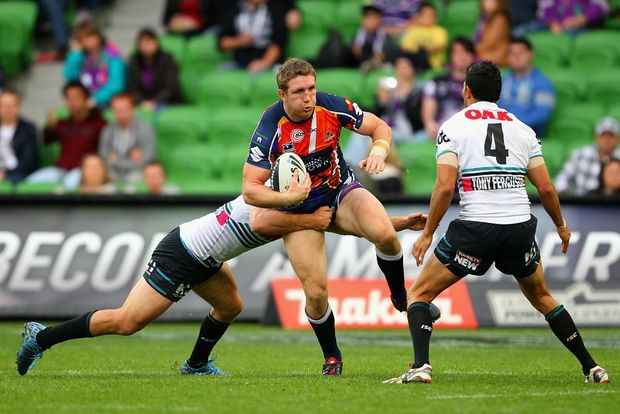 Ryan Hoffman of the Storm is tackled during the round 22 NRL match between the Melbourne Storm and the Penrith Panthers at AAMI Park on August 4, 2012 in Melbourne, Australia.