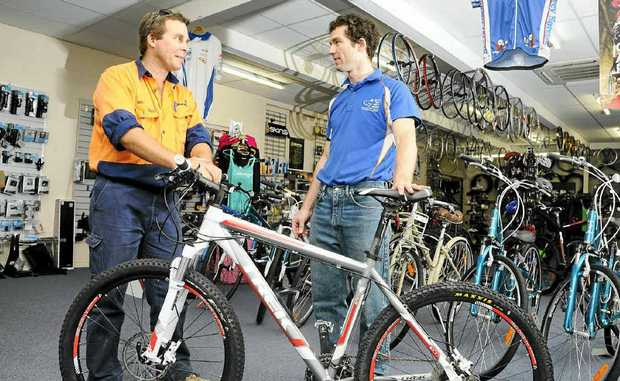 Craig Gillies, left, thrilled to get his son's bike back. He is pictured with Eddie McLane who found it.