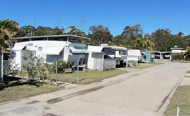 Housing Minister Bruce Flegg is standing by the decision to sell off Lazy Acres caravan park, despite public outcry.