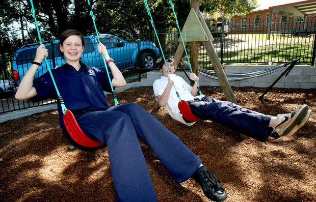 Murwillumbah High School students Stephanie Van Honk and Daniel Whitney-Clark test out the new swings.