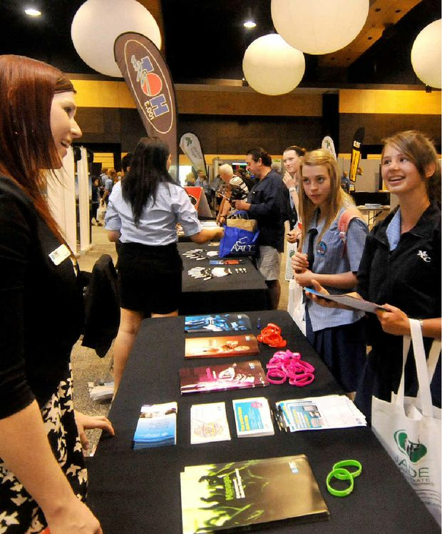 JMC Academy Creative Industries student recruitment and admissions officer Amina Kerr chats with Mackay Christian College students Annerie Grobbelaar and Michelle Gette at the expo.
